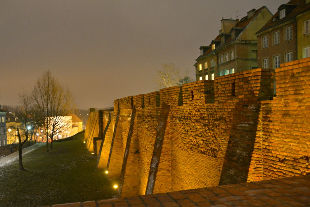 The medieval city walls at night in Warsaw.