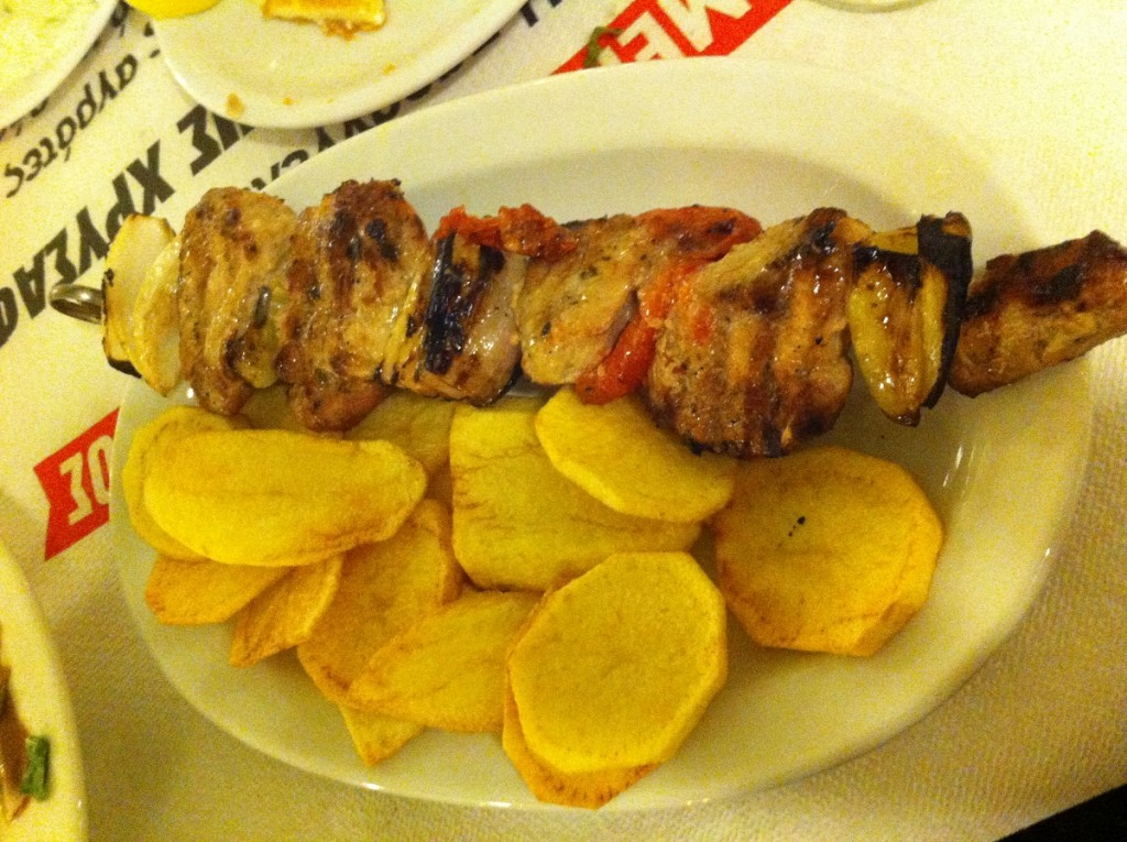 Chicken skewer and freshly fried potatoes.